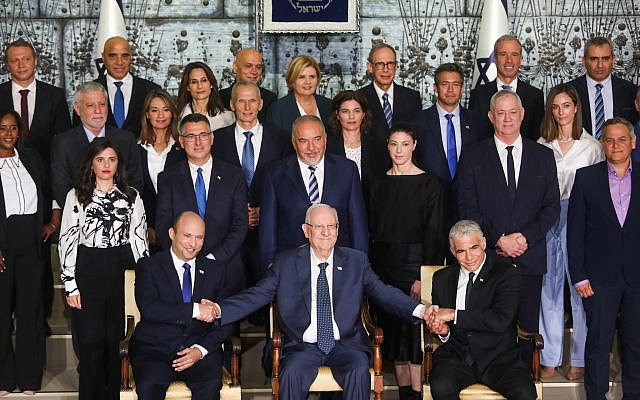 Ministers in the newly sworn in Israeli government pose for a group photo at the president's residence in Jerusalem. June 14, 2021. (Yonatan Sindel/FLASH90)